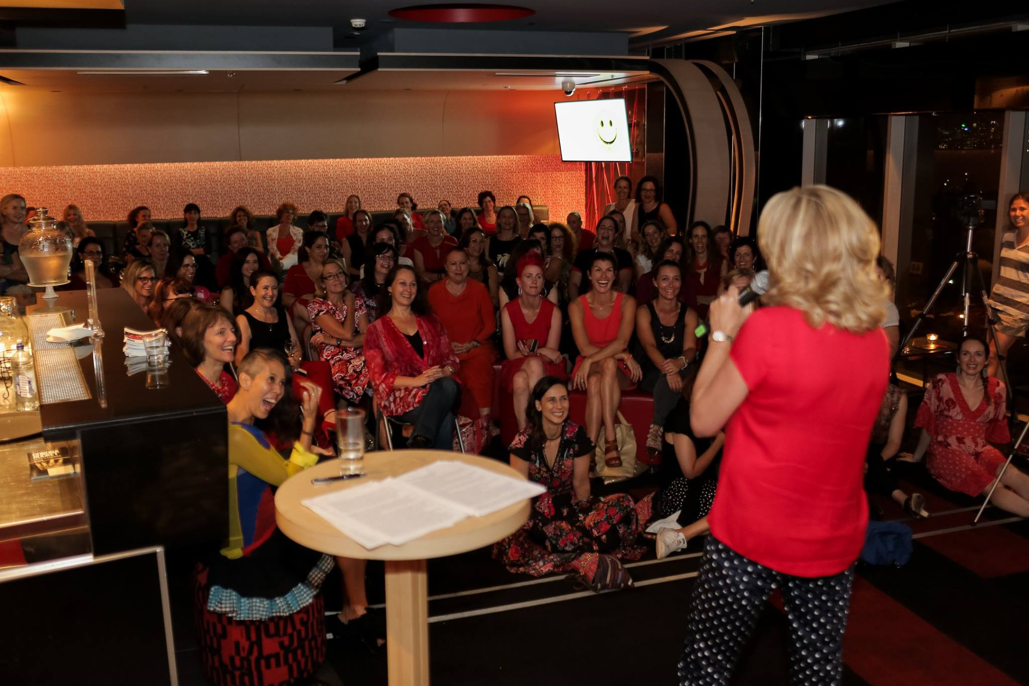 Comedienne and author Jean Kittson captivating the room of women in red