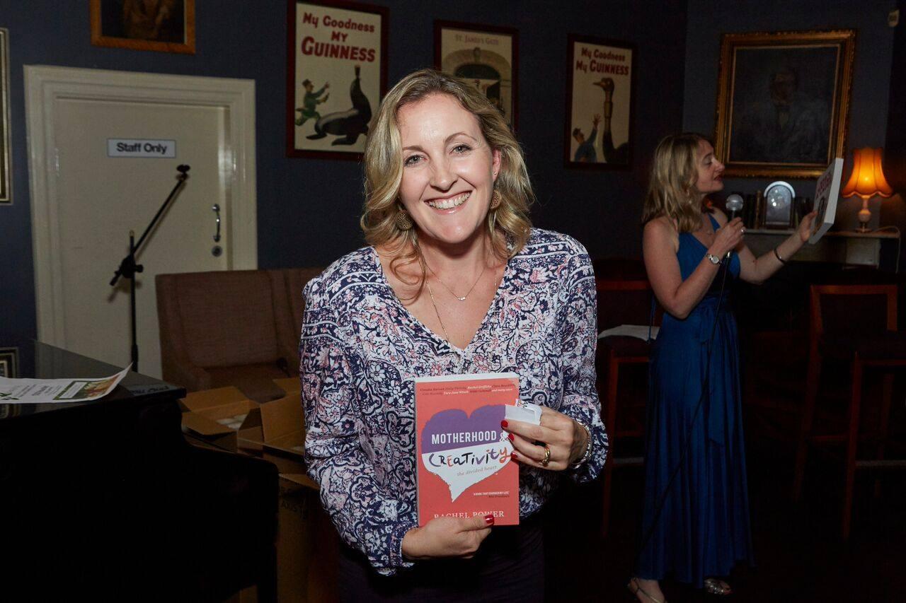 A happy raffle winner who won the seminal book 'Motherhood & Creativity: The Divided Heart by Rachel Power, courtesy of Affirm Press