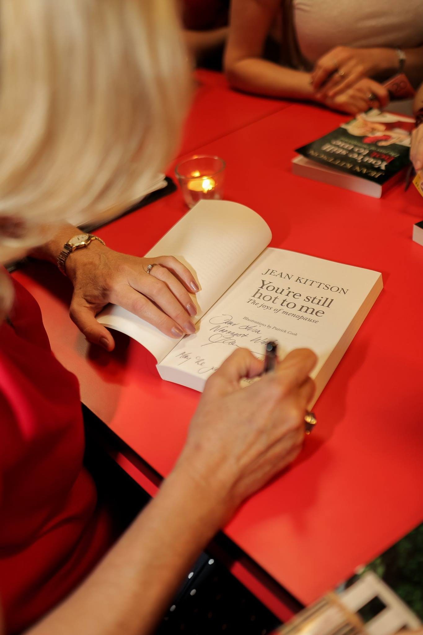 Jean Kittson, comedienne and author of 'You're Still Hot to Me', signing her amazing book about female hormones and menopause. A humorous yet well researched read, worth buying for any woman with hormones (and their partners)!