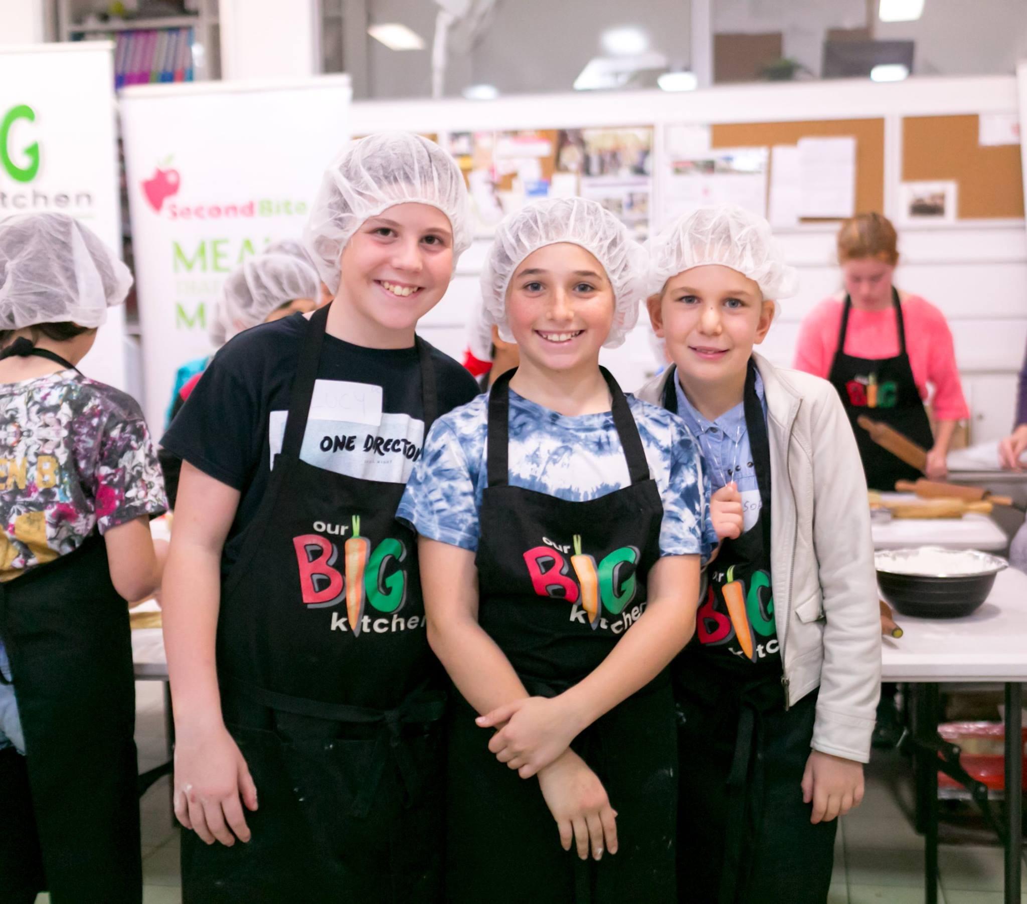 Generous hearted kids helping to make cookies & breadrolls