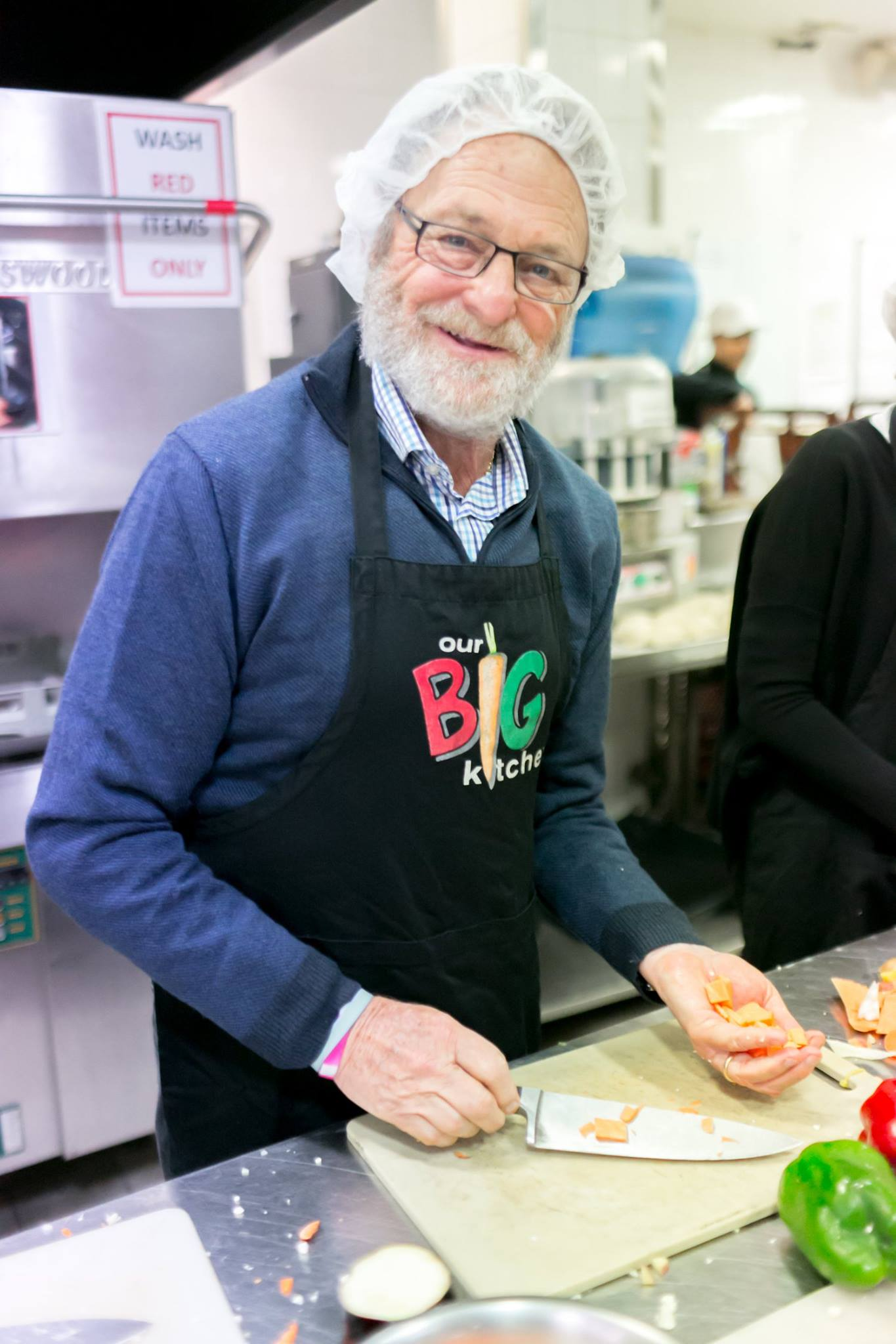 Tom Moss in the kitchen helping to prepare hot meals