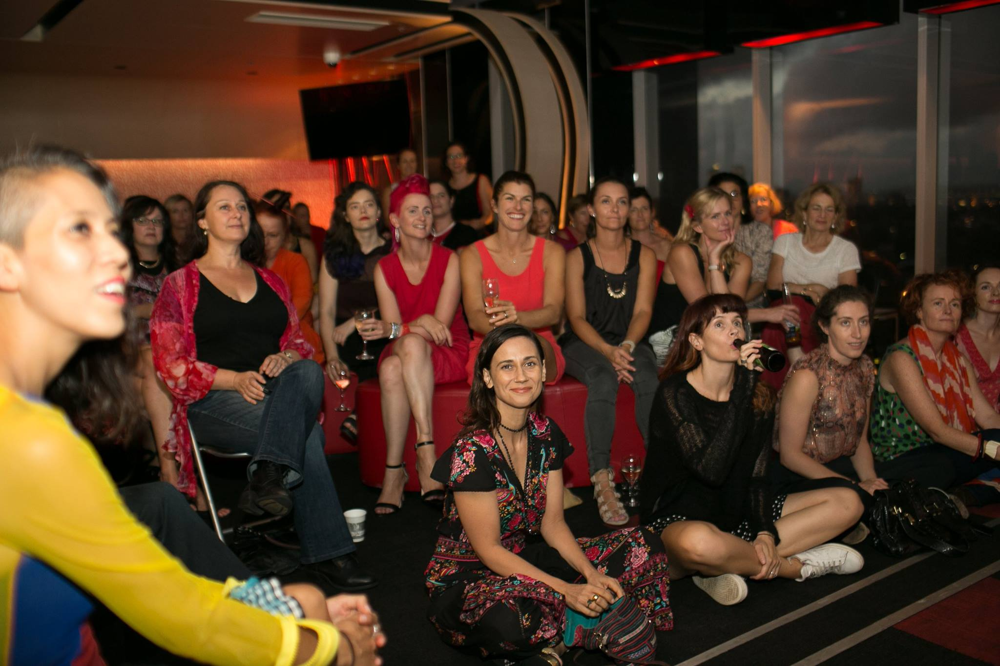 A room full of women in red