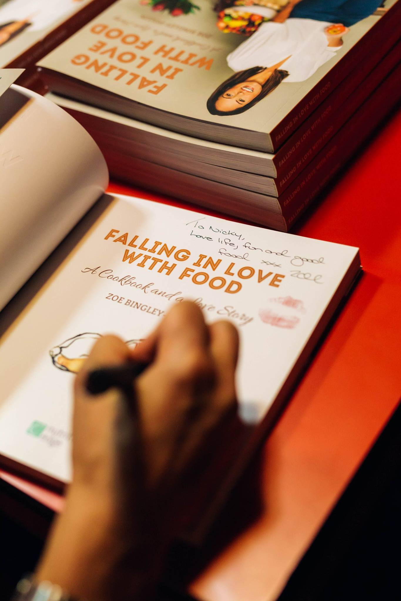 Zoe Bingley-Pullin generously signs copies of her latest cookbook, 'Falling in Love with Food'.