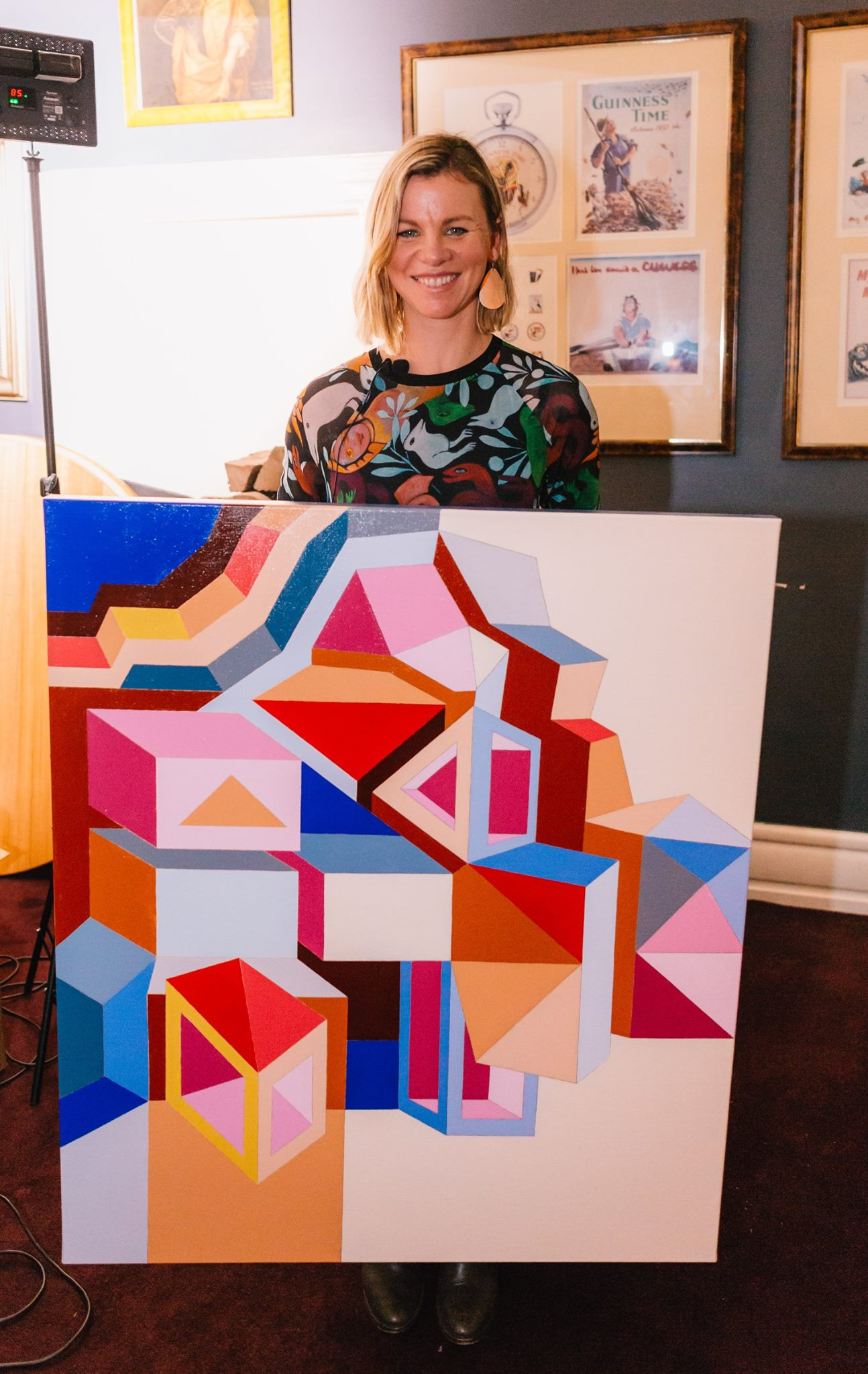 The very talented painter Jasmine Mansbridge with a painting from her recent and almost sold out show at Koskela.