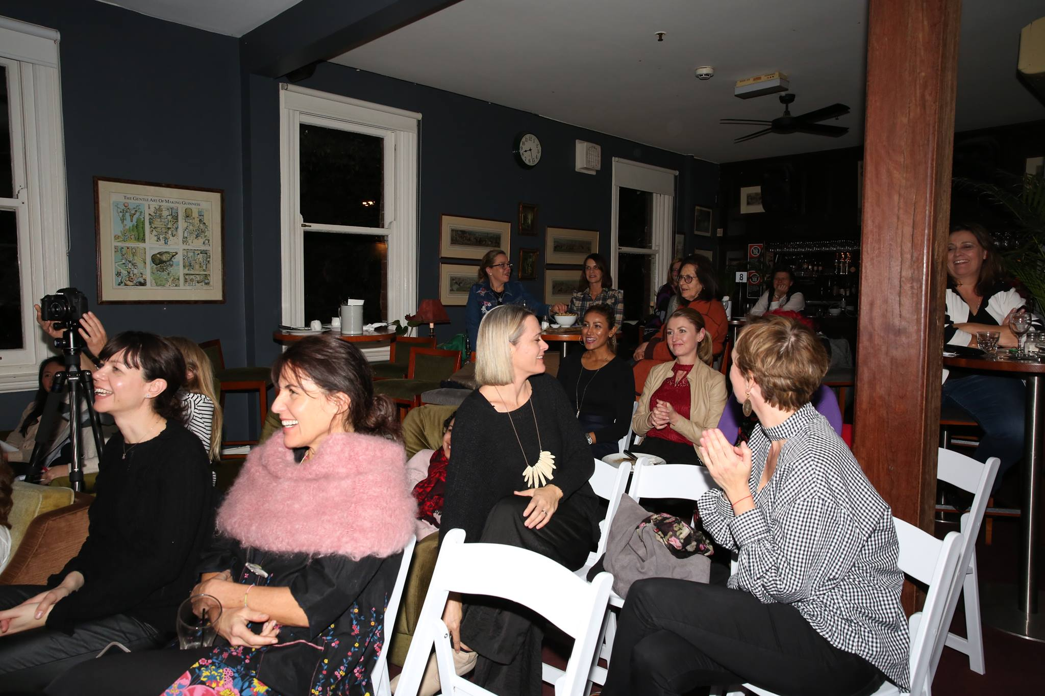 A roomful of creative mamas enjoying the story of our fabulous featured evening presenter.