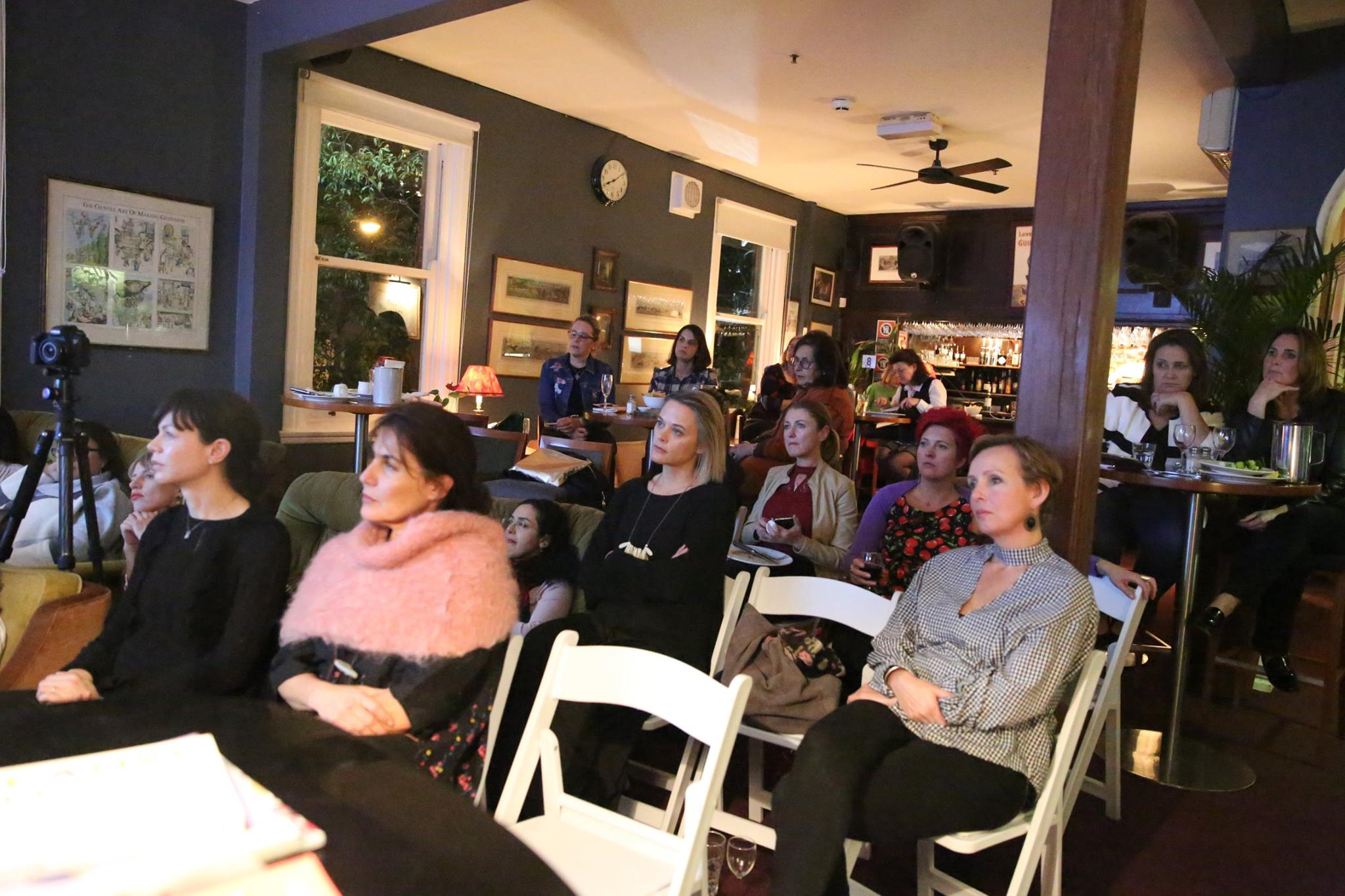 A roomful of creative mamas entralled by the story of our fabulous featured evening presenter, Emma Veiga-Malta.