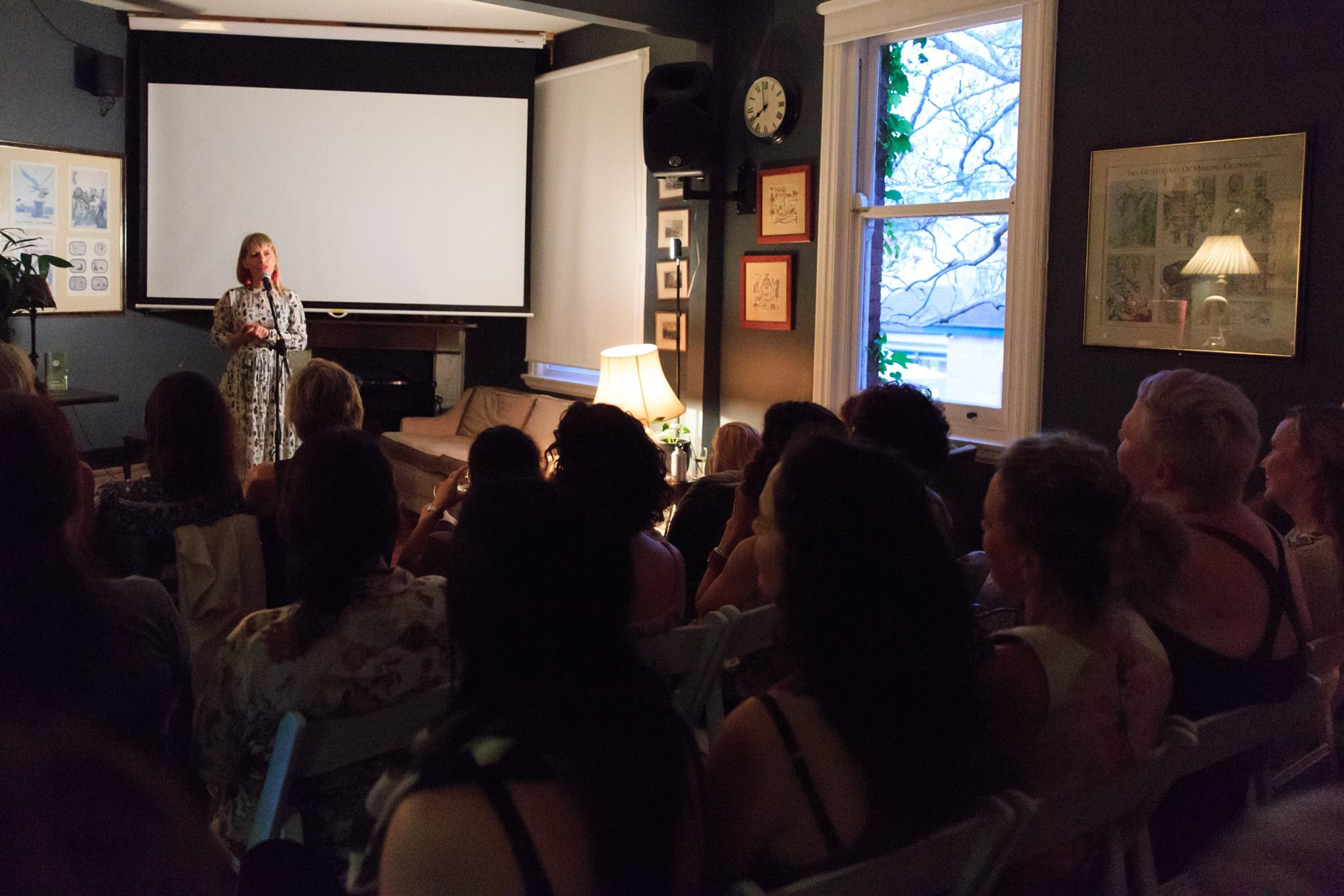 In action! Courageous speaker Carli Leimbach, sharing her story of courage, at our Mama Creatives Story Slam.